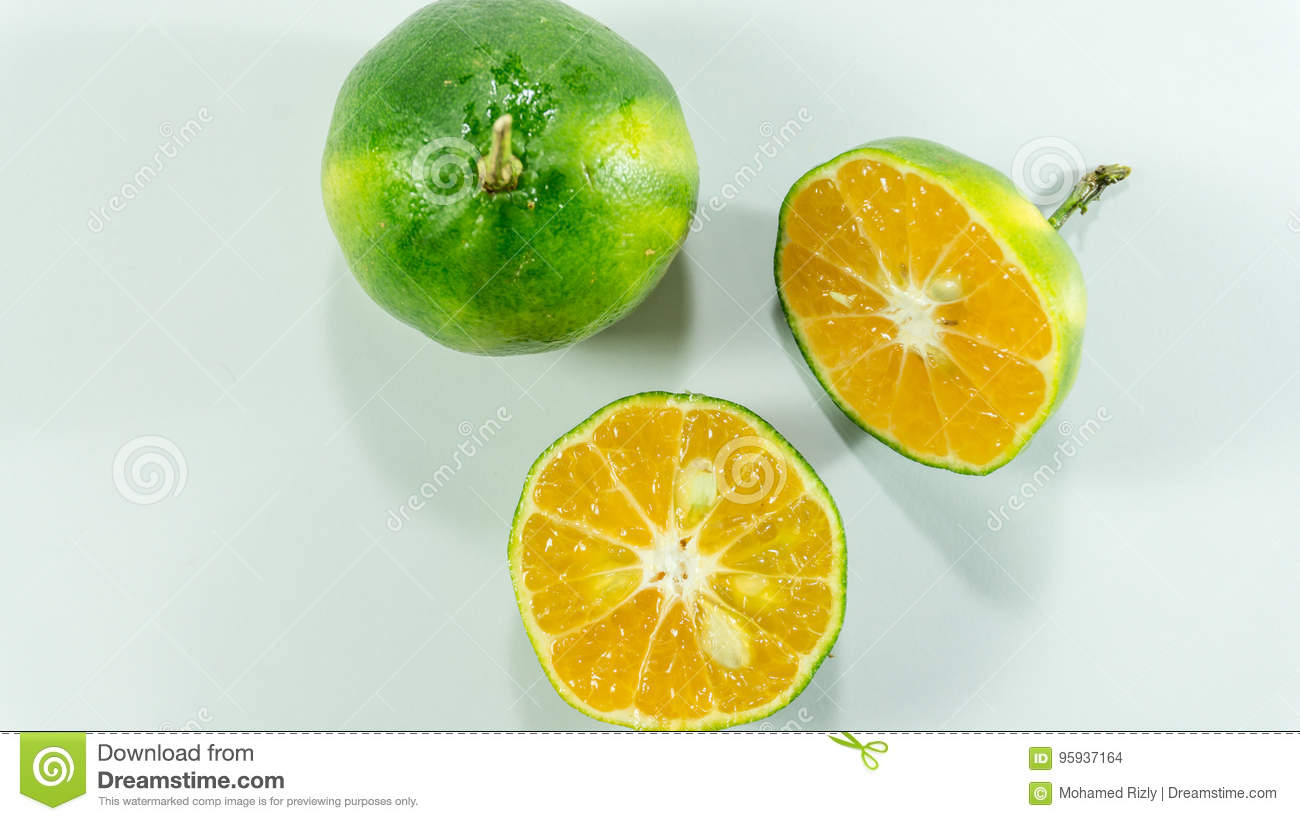 Tangerines and slice on the white background