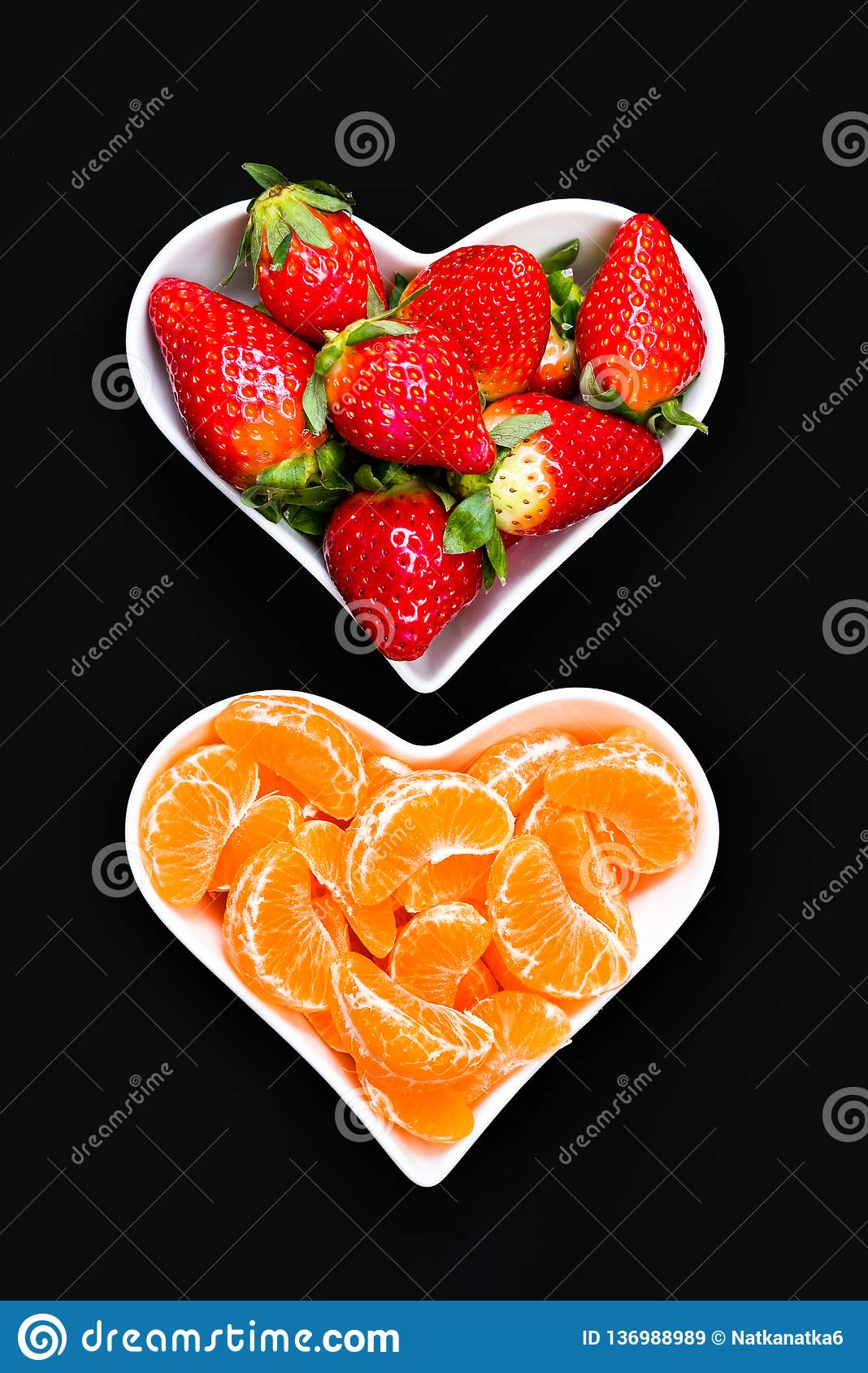 Strawberries and tangerine slices in white plates