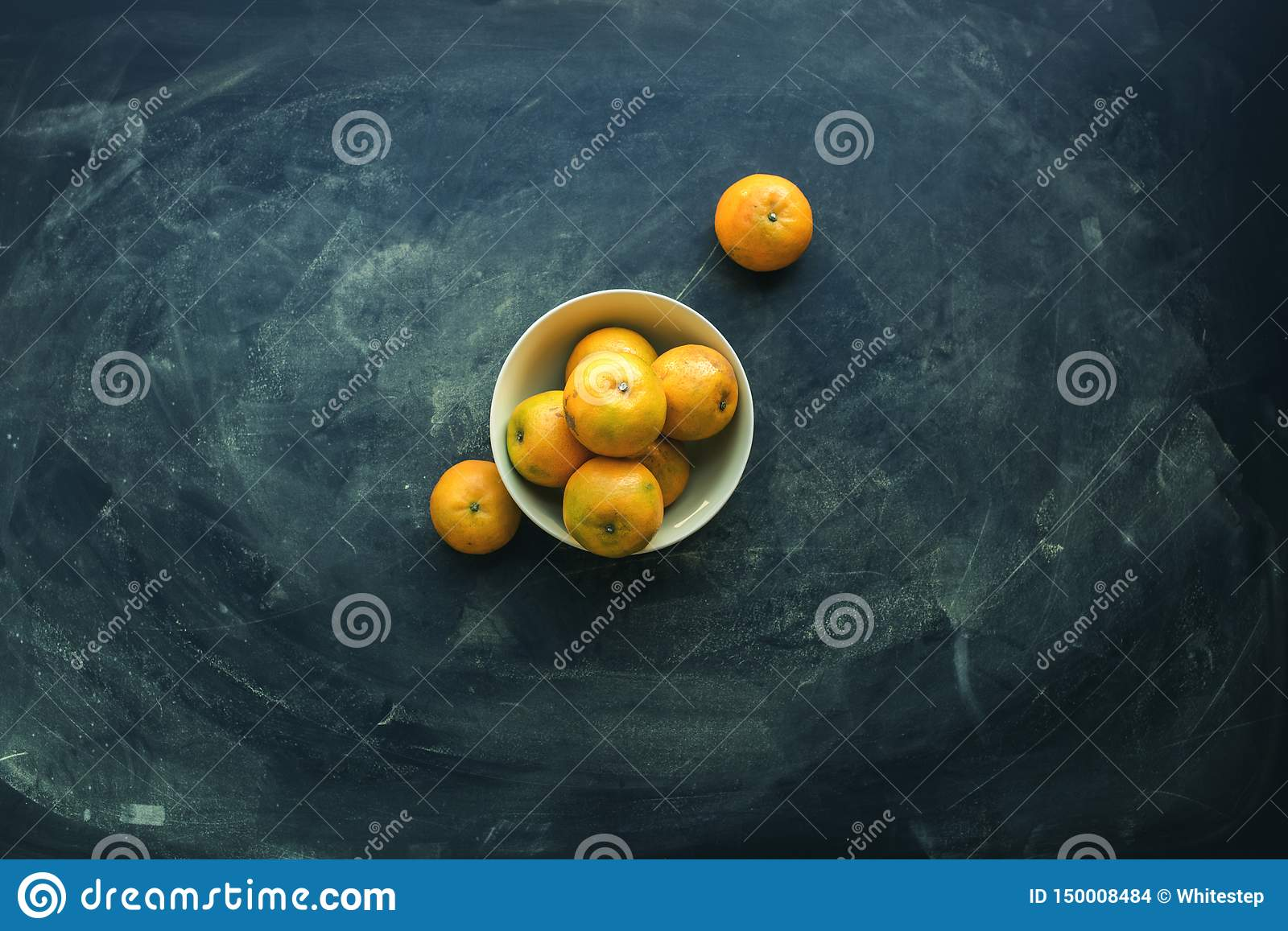 Tangerines in bowl on dark background. Super food