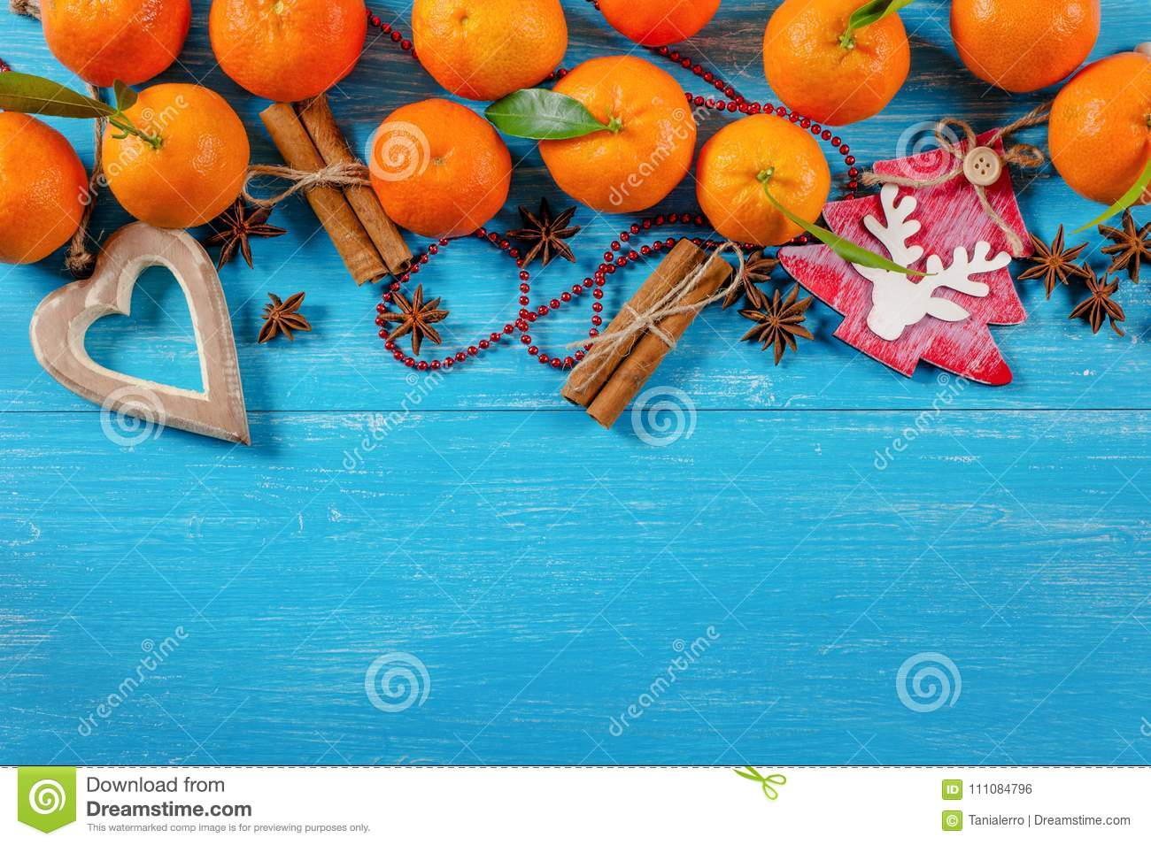 download tangerines cinnamon stick heart and christmas tree decoration on a wooden background stock
