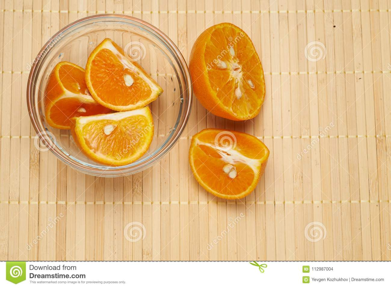tangerines in a glass plate on a bamboo background