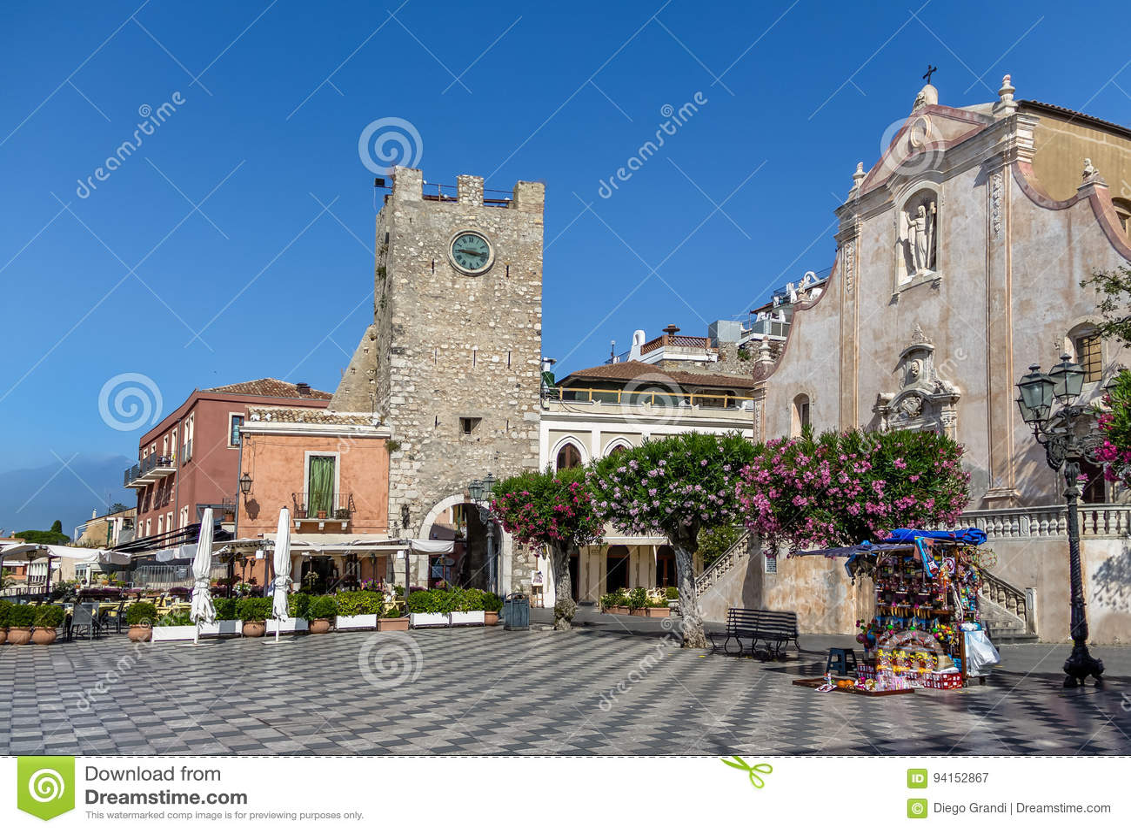Taormina main square with San Giuseppe Church and the Clock Tower - Taormina, Sicily, Italy