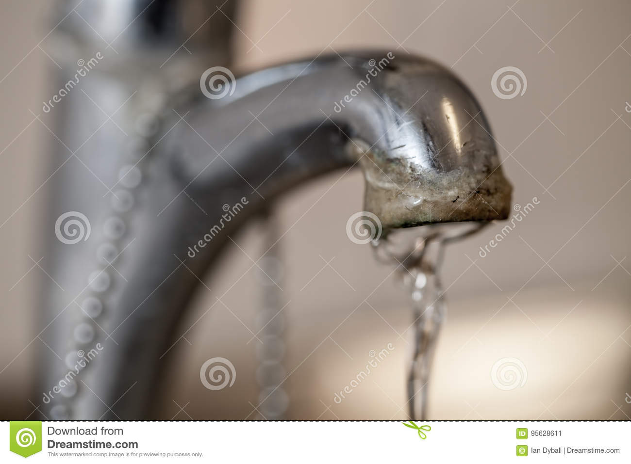 Tap limescale. Selective focus on the hard water deposit of a ru