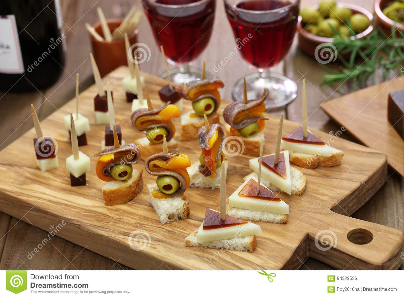 Tapas pinchos spanish canapes stock photo image 64329536 for Canape party menu