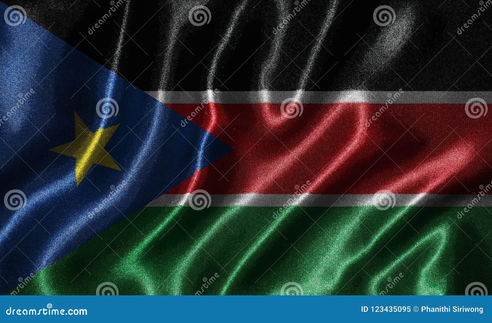 Tapet av den södra Sudan flaggan och den vinkande flaggan vid tyg