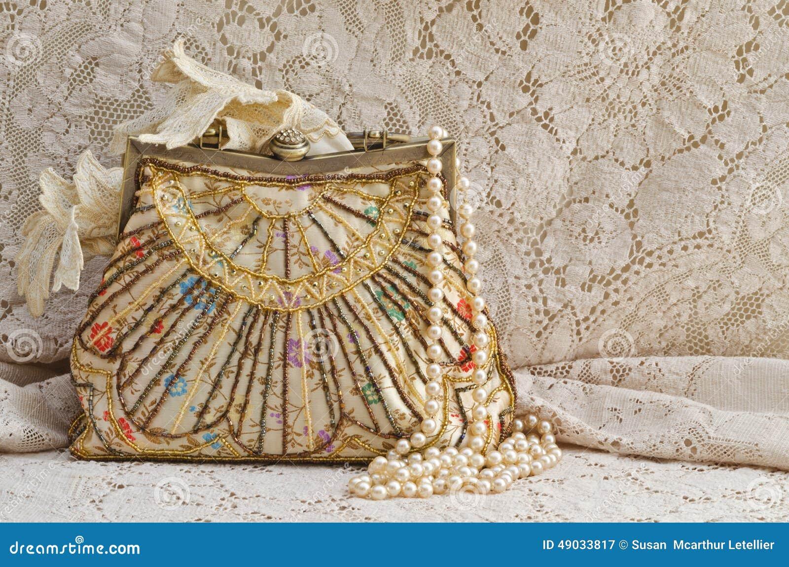 Tappninghandväska och pärlor