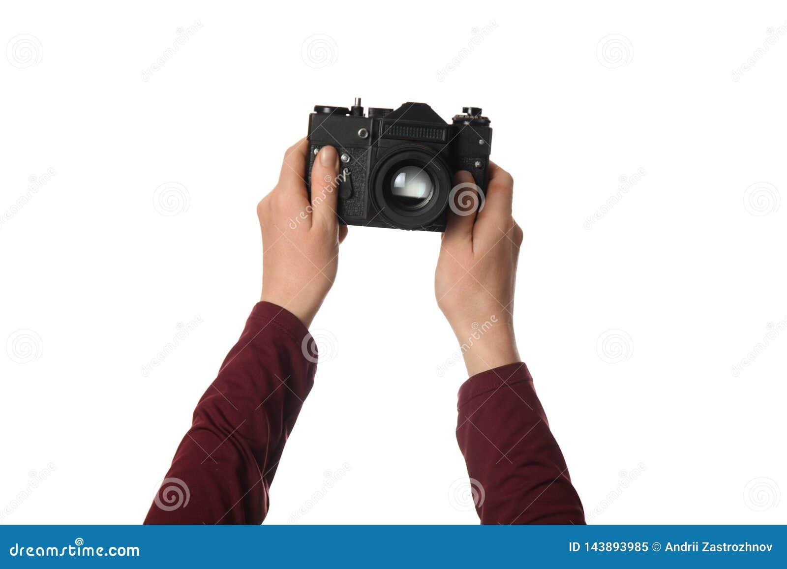 Tappningkamera i handen som isoleras p? vit bakgrund Fotografi och minnen