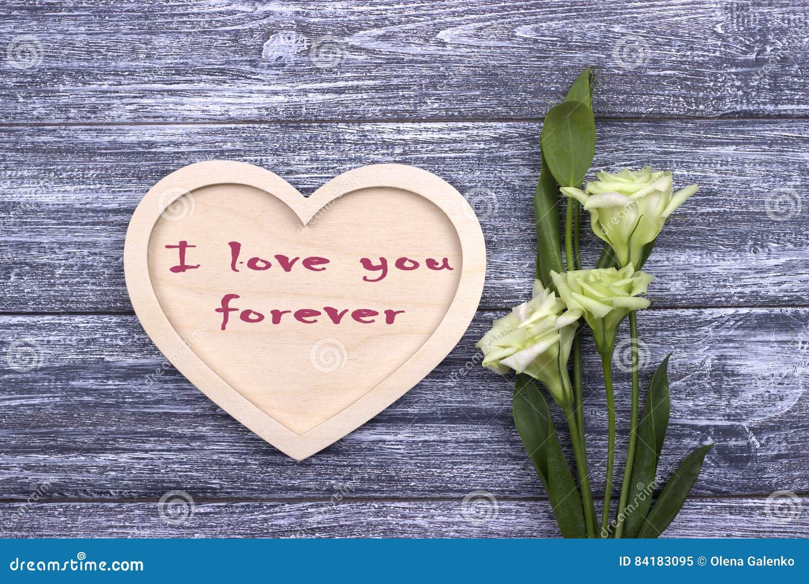 Tarjeta de la tarjeta del día de San Valentín con el texto te amo para siempre