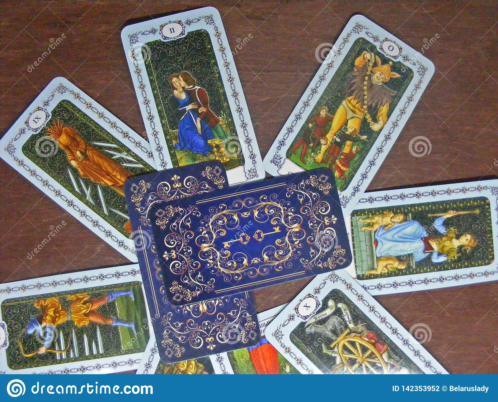 Tarot card reading concept. Medieval tarot on wooden table