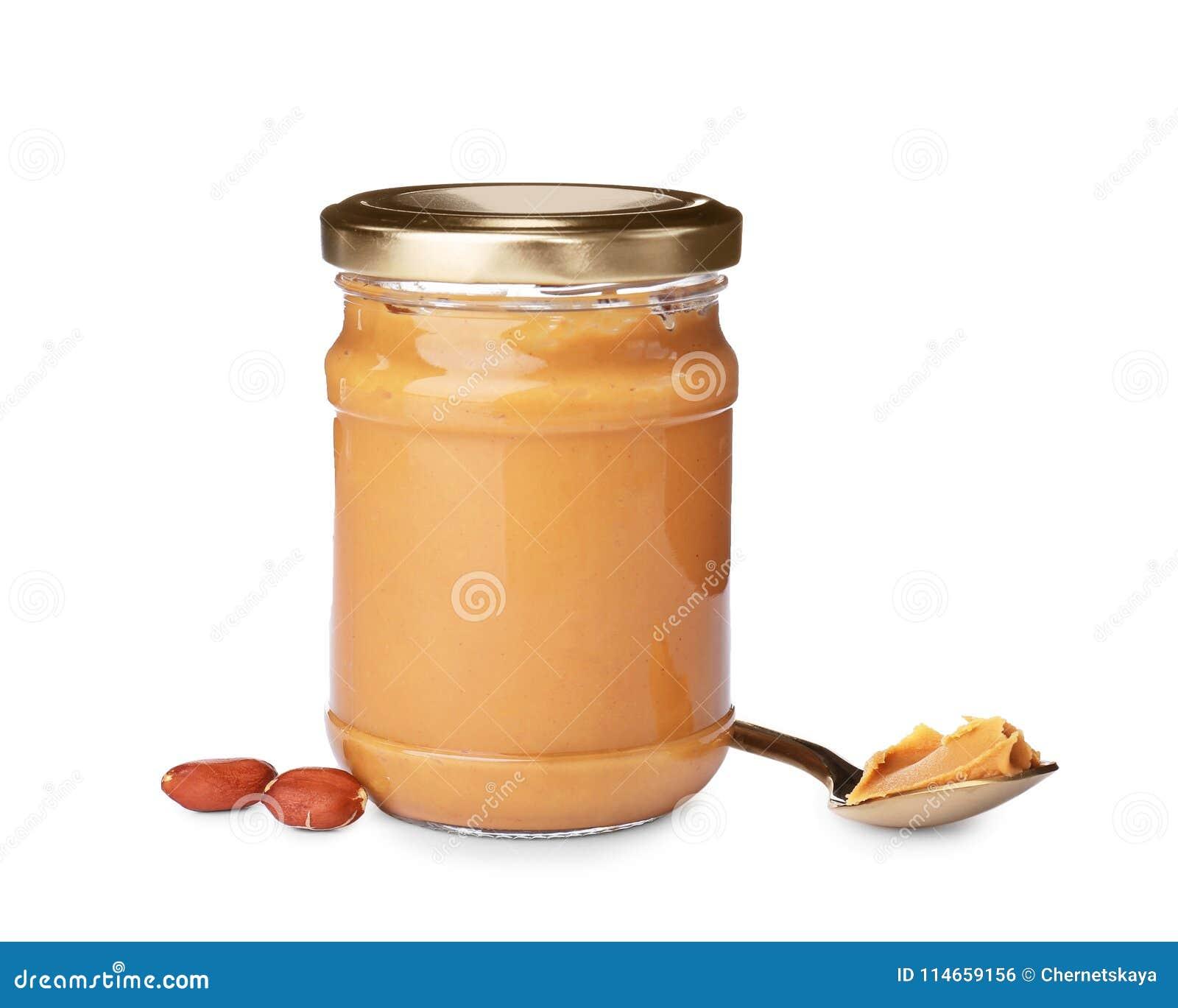 Tarro y cuchara con mantequilla de cacahuete cremosa