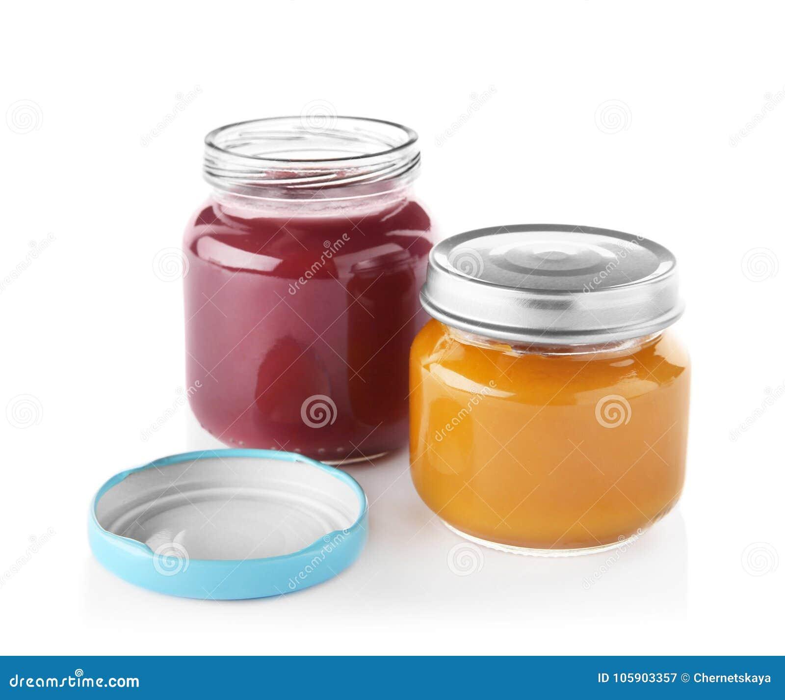 Tarros de cristal con los alimentos para niños nutritivos en fondo