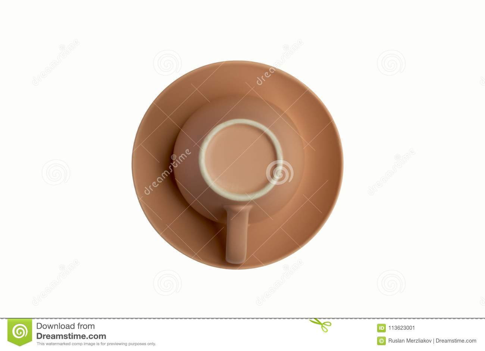 Tasse rose sur une soucoupe