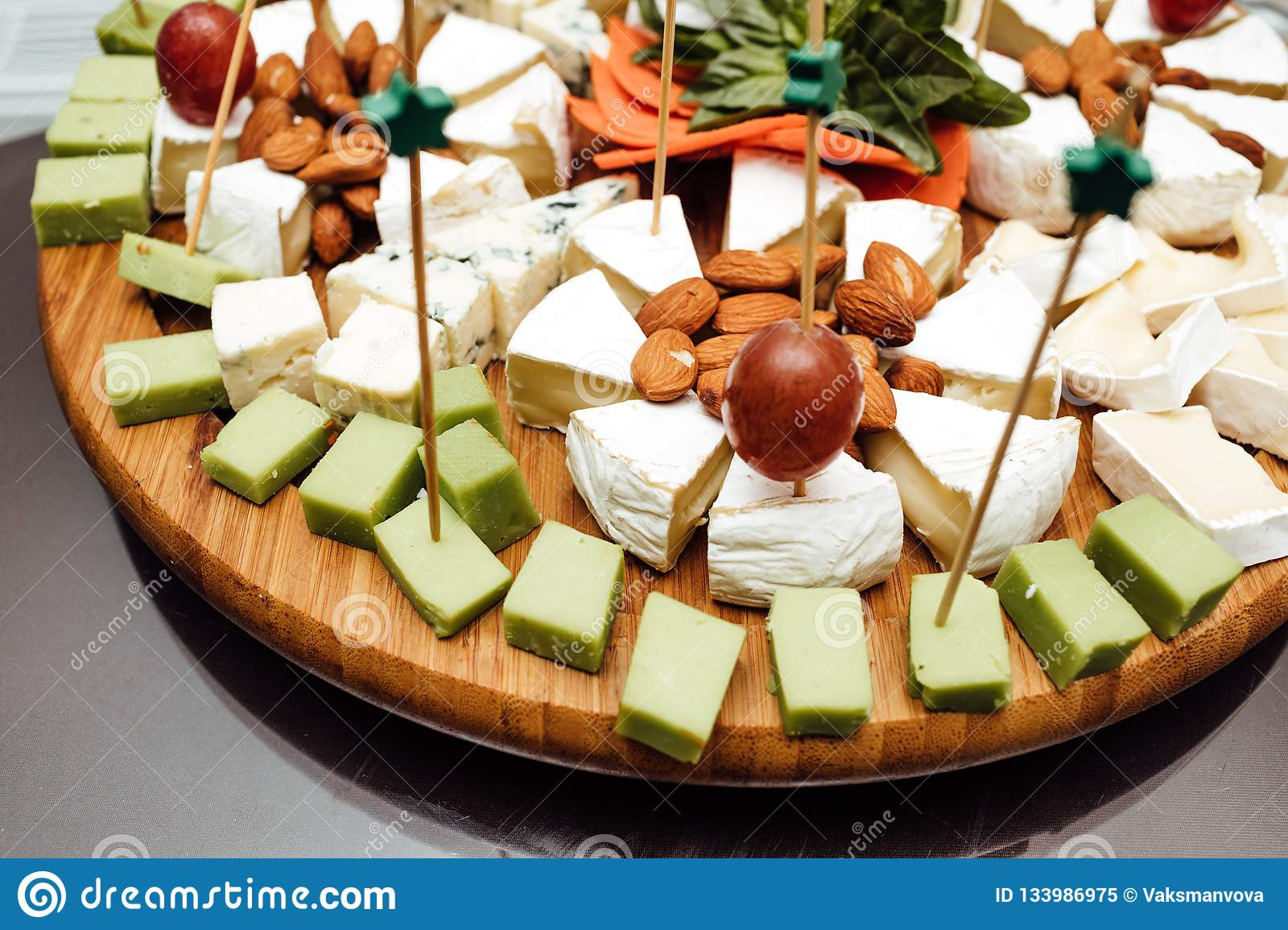 Tasting cheese dish . Delicious cheese on the table. Table setting at a luxury wedding reception.