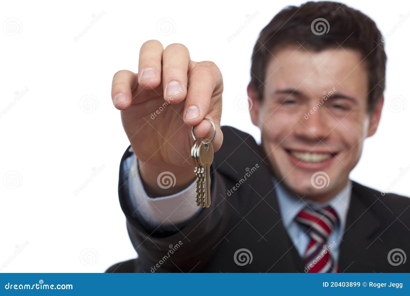 Tasto felice della casa di overgives dell agente immobiliare