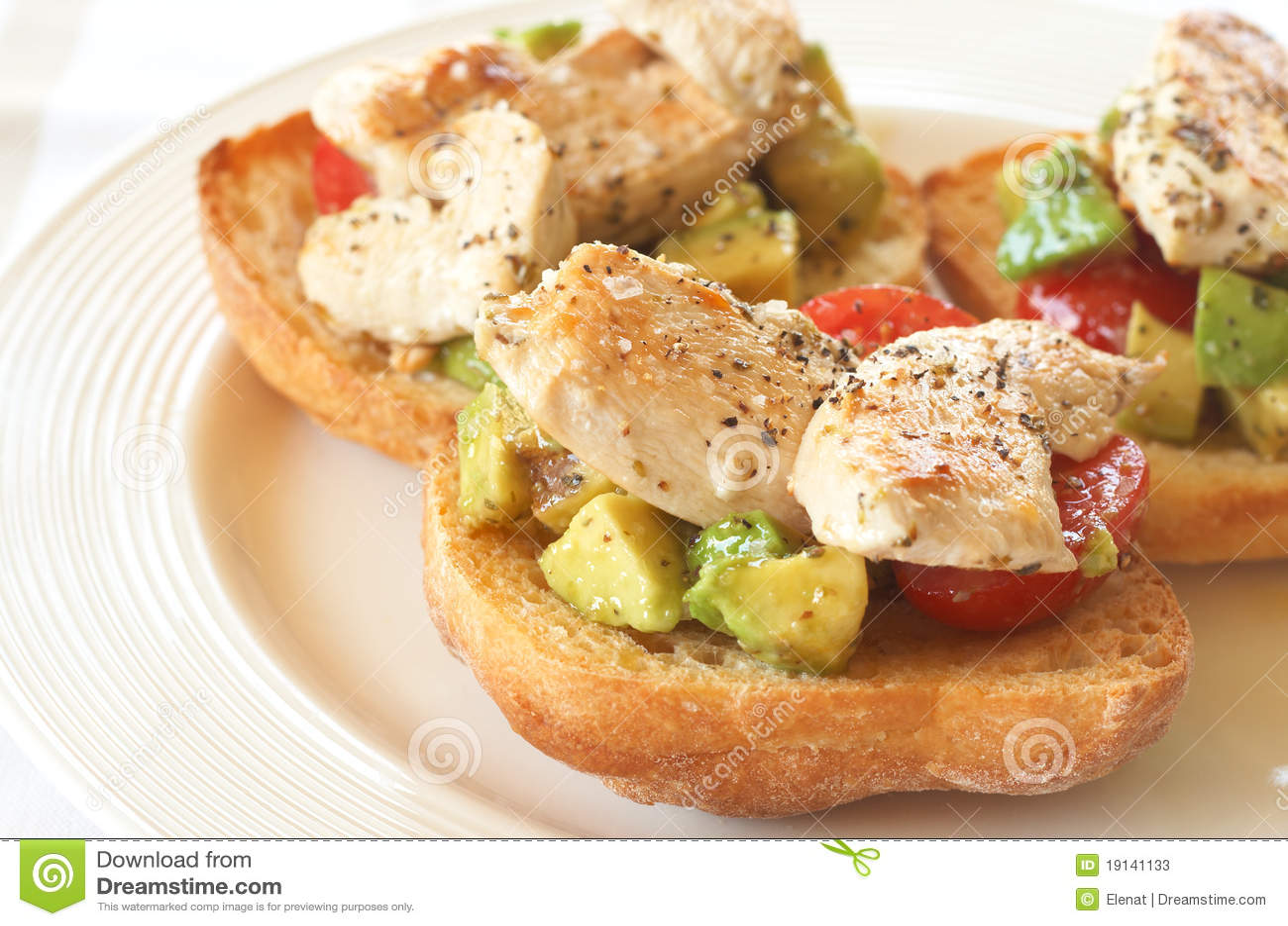 Tasty avocado, tomato and chicken bruschetta