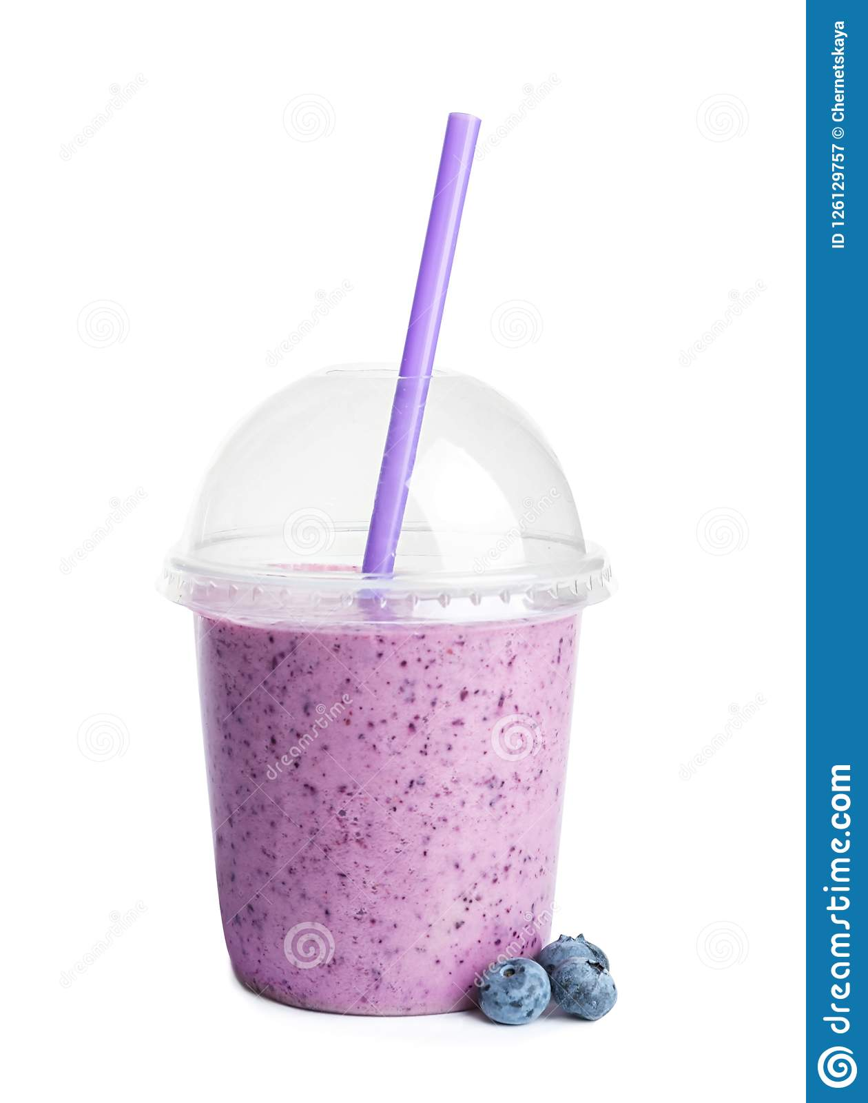 Tasty blueberry smoothie in plastic cup