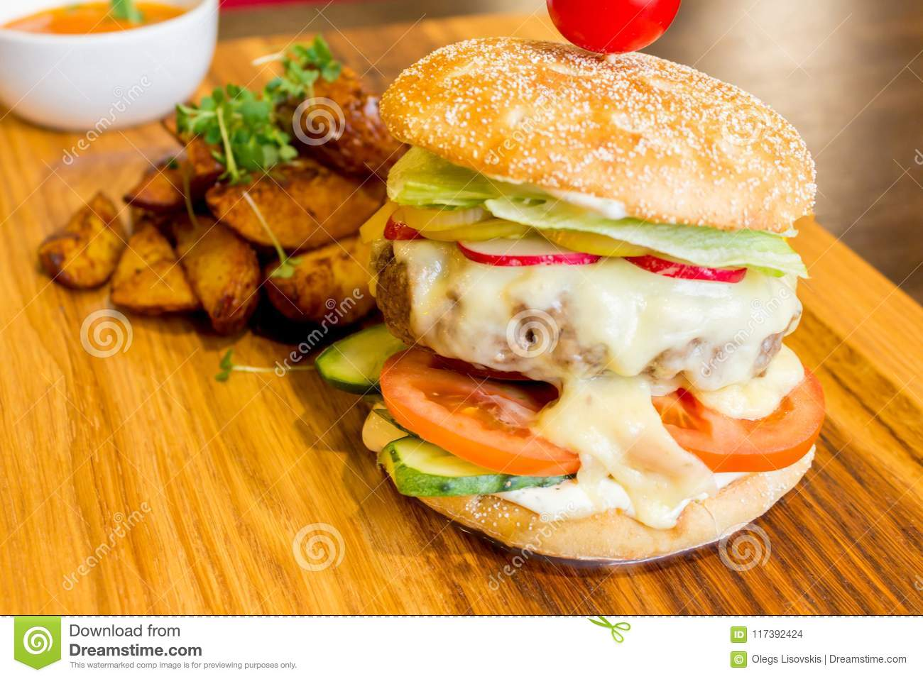 Tasty Burger On A Wooden Platter Stock Photo Image Of Cucumber Black 117392424