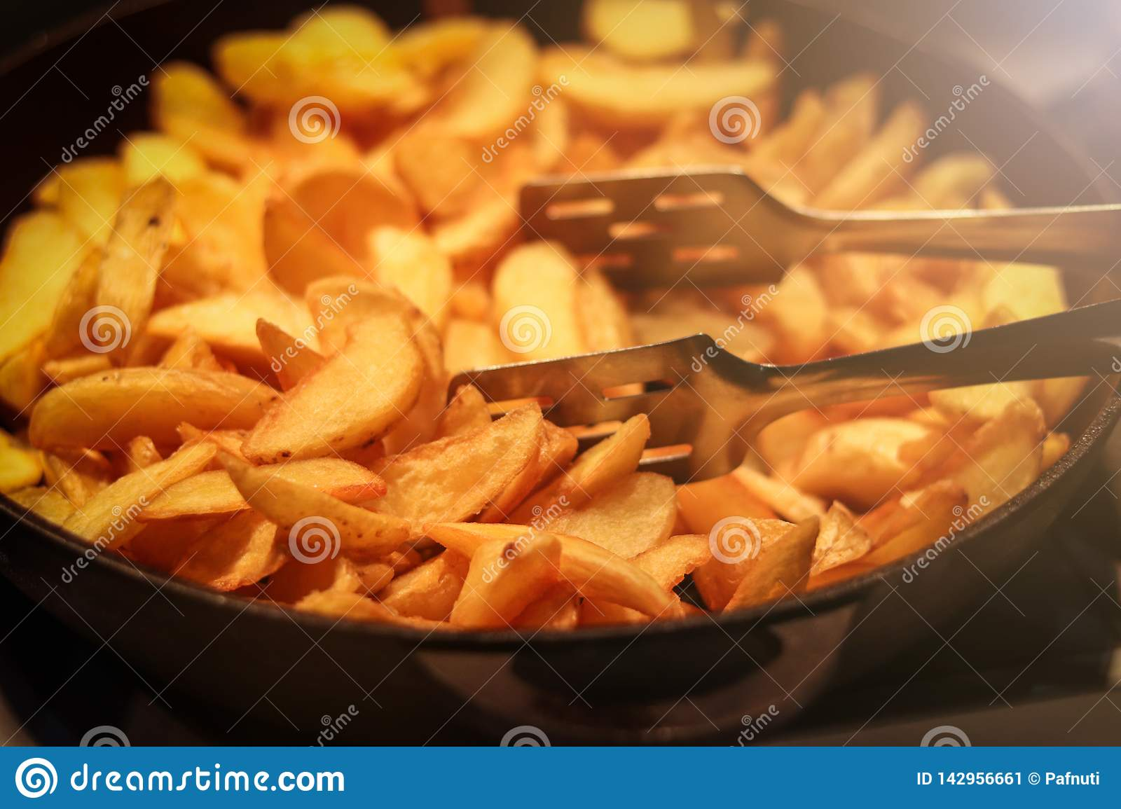 Tasty crispy fried wedges of potato served