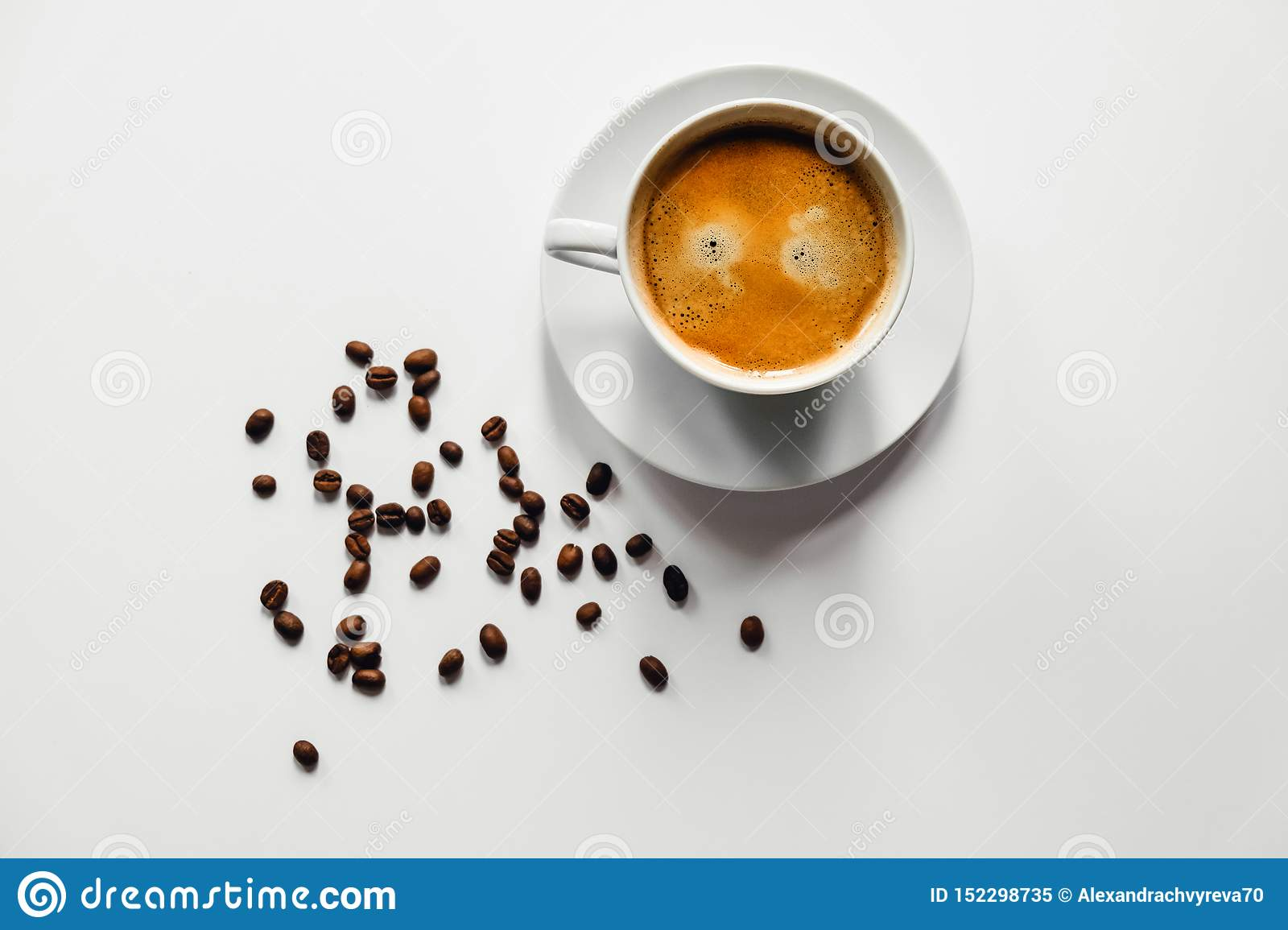 Tasty cup of coffee on white desk