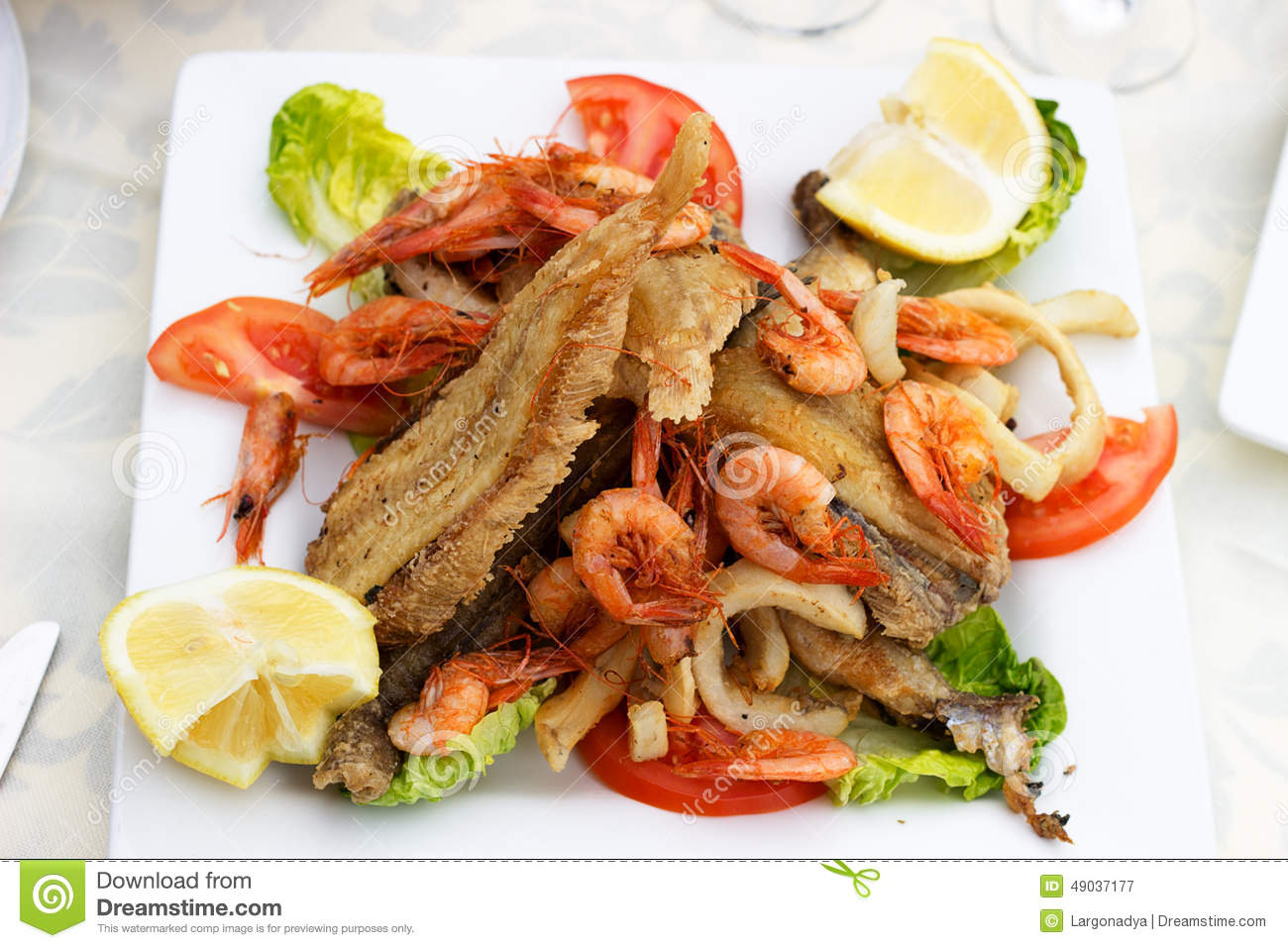 Tasty fish with seafood for Fried fish and shrimp