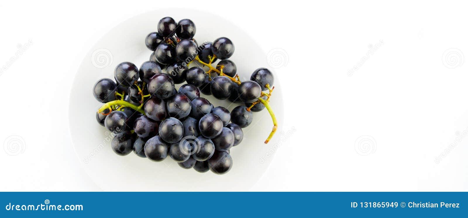 Tasty fresh black grape in a bowl