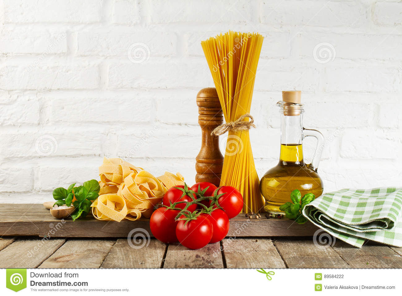 Download Tasty Fresh Colorful Italian Food Raw Spaghetti On Kitchen Table Stock Photo - Image of bundle, culinary: 89584222