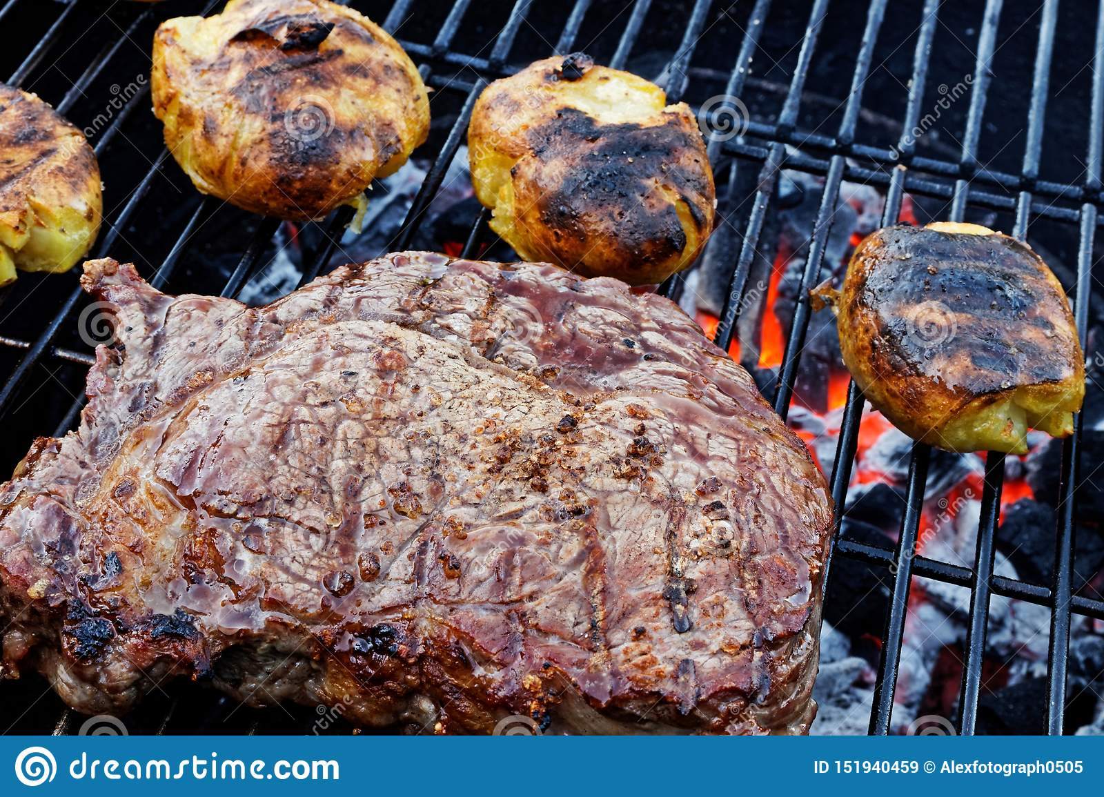 Big Rib Eye Steak And Smashed Potatoes On The Charcoal Grill Stock Image Image Of Meat Potatoes 151940459