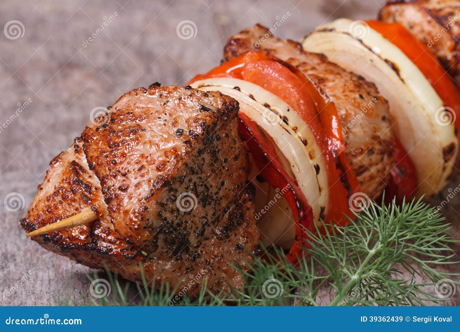 Tasty grilled shish kebab with vegetables