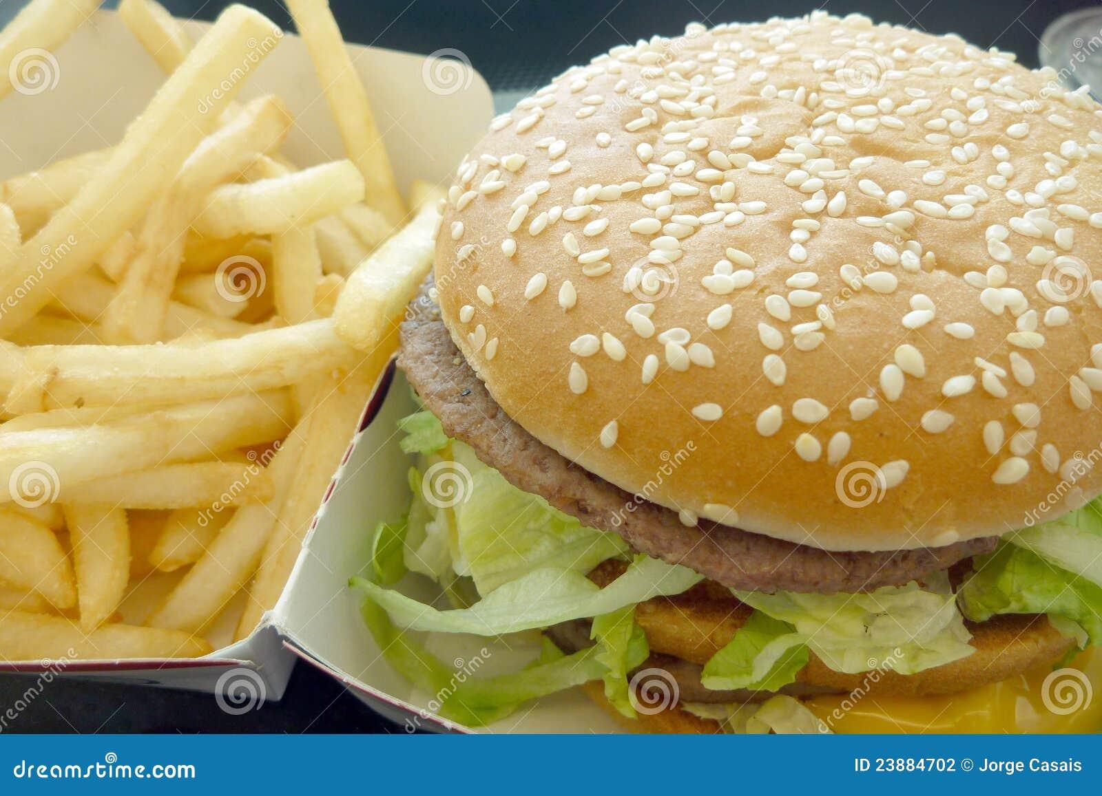 Tasty hamburger with fries, unhealthy food, health concept