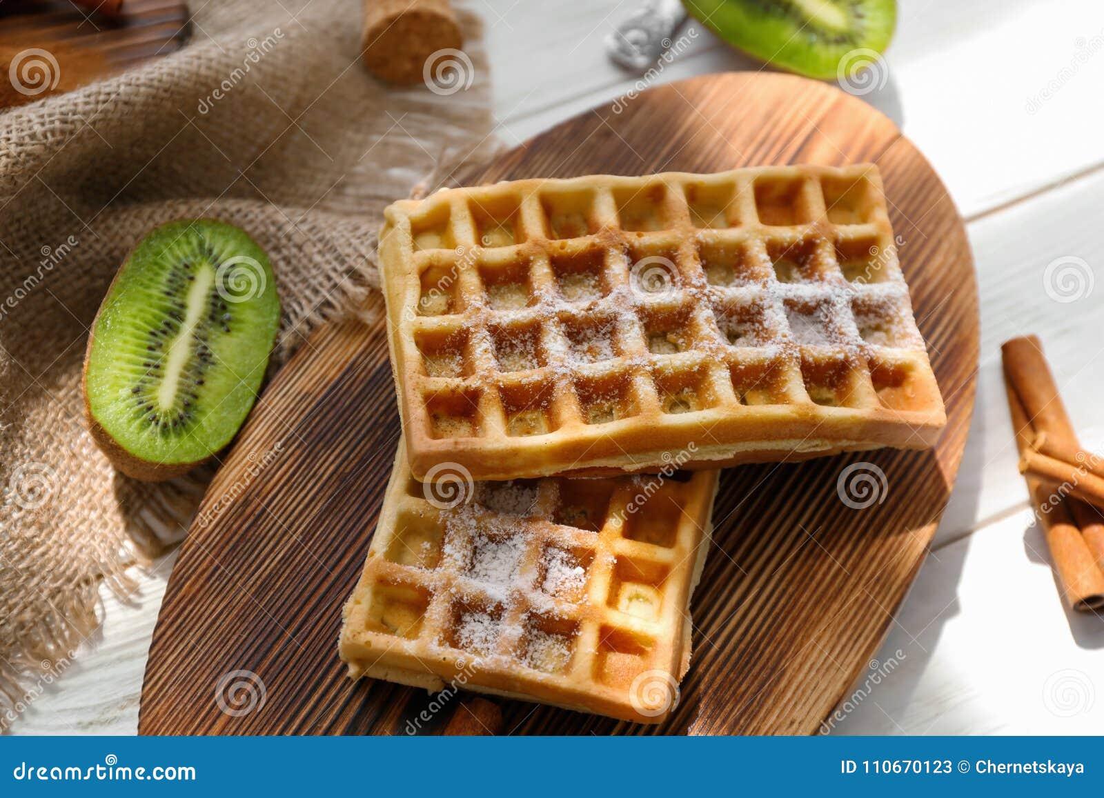 Tasty homemade waffles with sugar powder