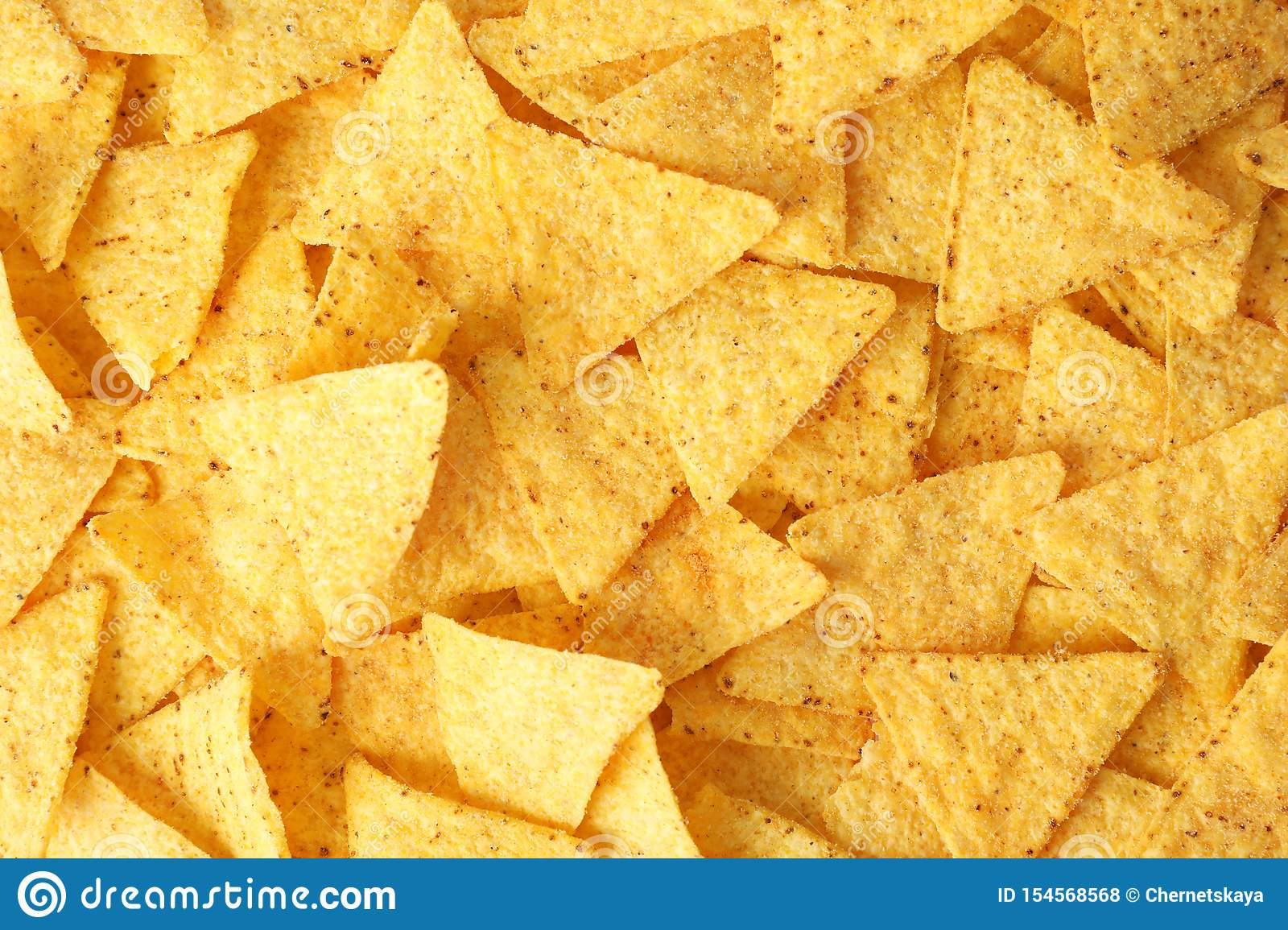 Tasty Mexican nachos chips as background