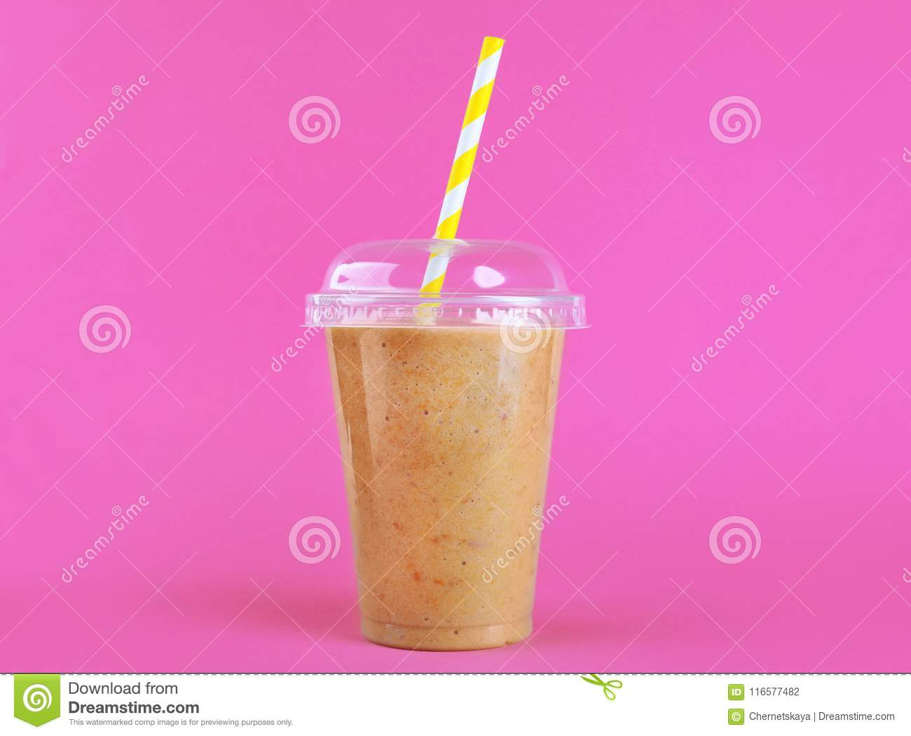 Tasty peach milkshake in plastic cup