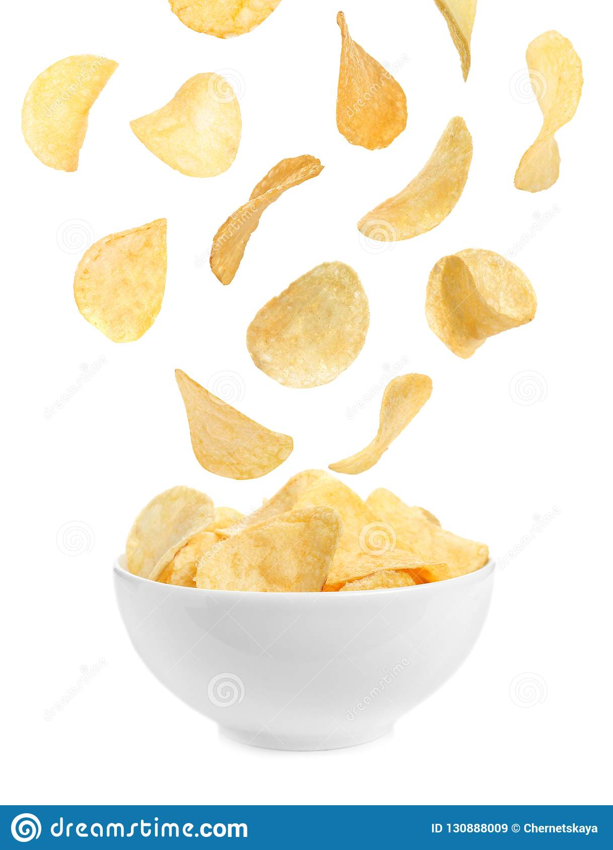 Tasty potato chips falling into blow
