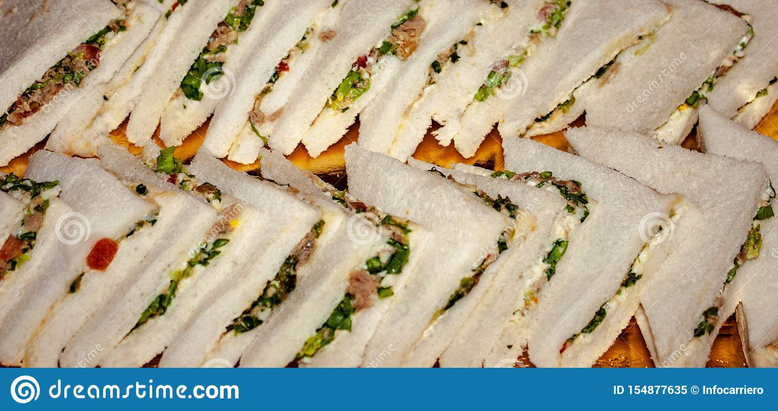 Tasty sandwiches ready to be enjoyed, placed on a tray, the sandwich, bread stuffed with what is considered the best is a sandwic