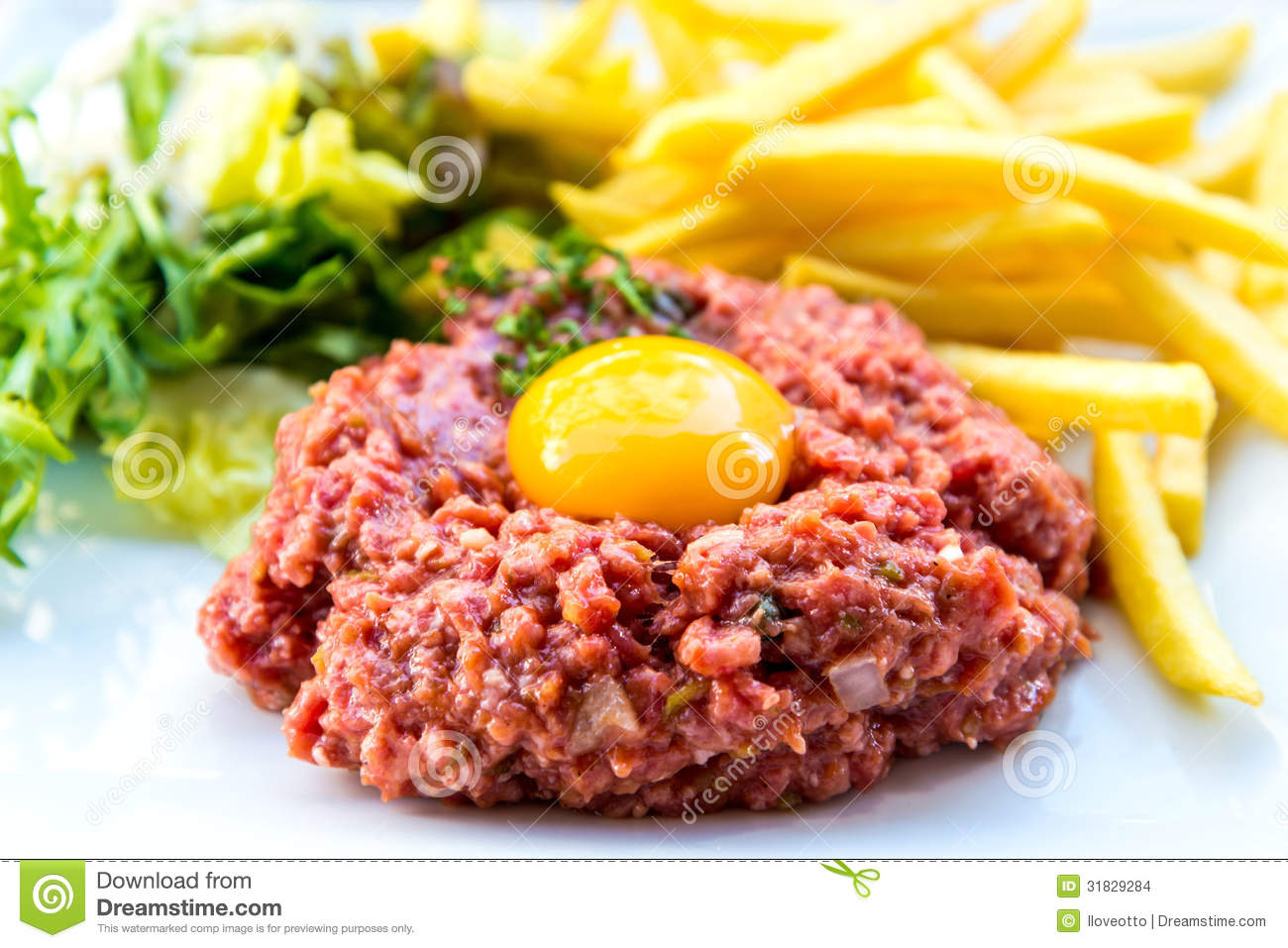 Tasty Steak tartare (Raw beef) - classic steak tartare on white plate.