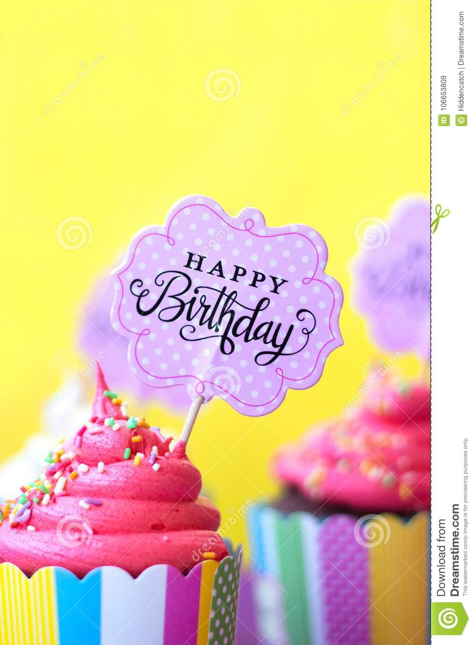 Tasty Strawberry Cupcakes With Happy Birthday Greeting Card On Y