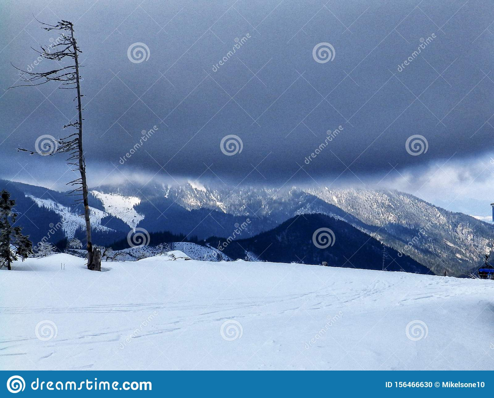 Tatra mountain peaks evening light, winter evening, slovakia mountains and rocks covered with snow, overcast winter day