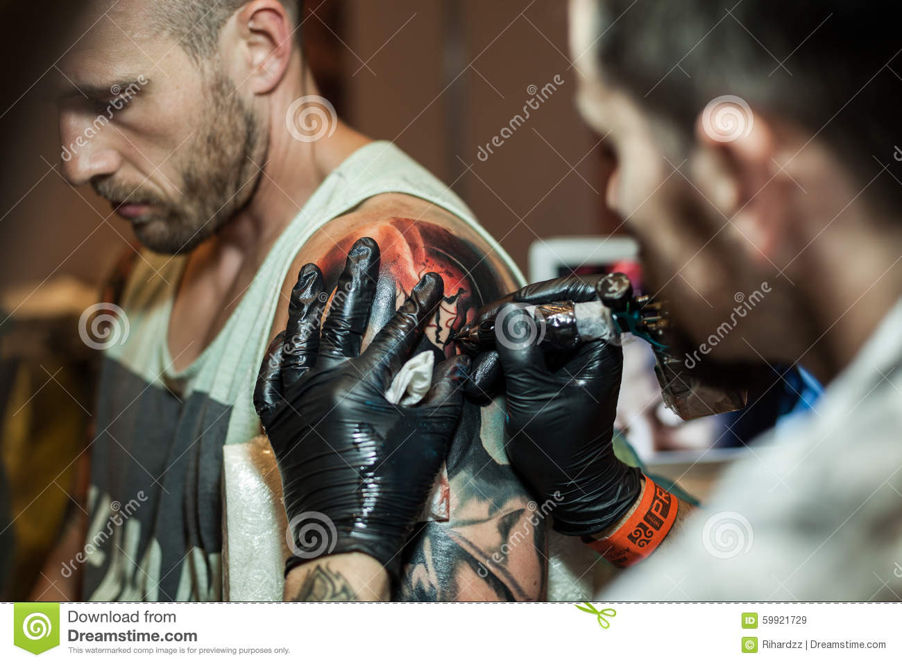 Tattoo Artists At Work Editorial Stock Image - Image: 59921729