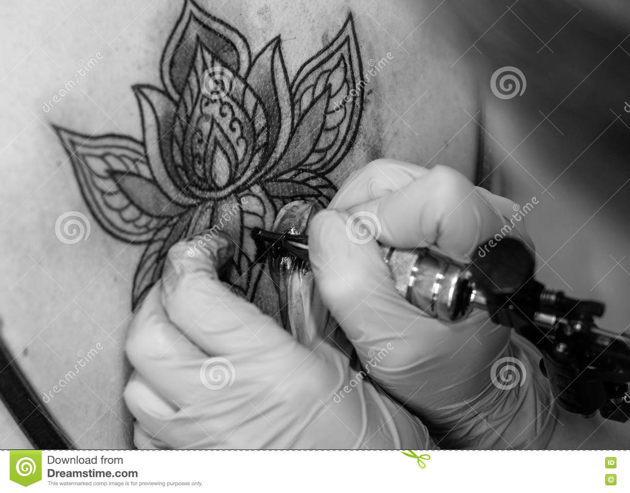 Tattoo flower on the woman s back