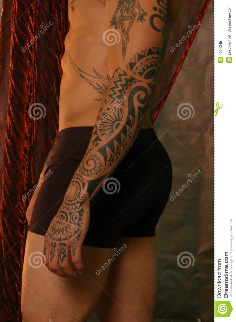 Male with a dragon tattoo and tattoos on his hand