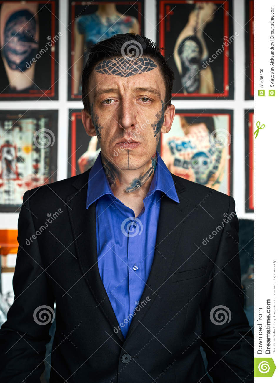 Tattoo Master In Black Jacket And Blue Shirt In Studio Stock Photo ...