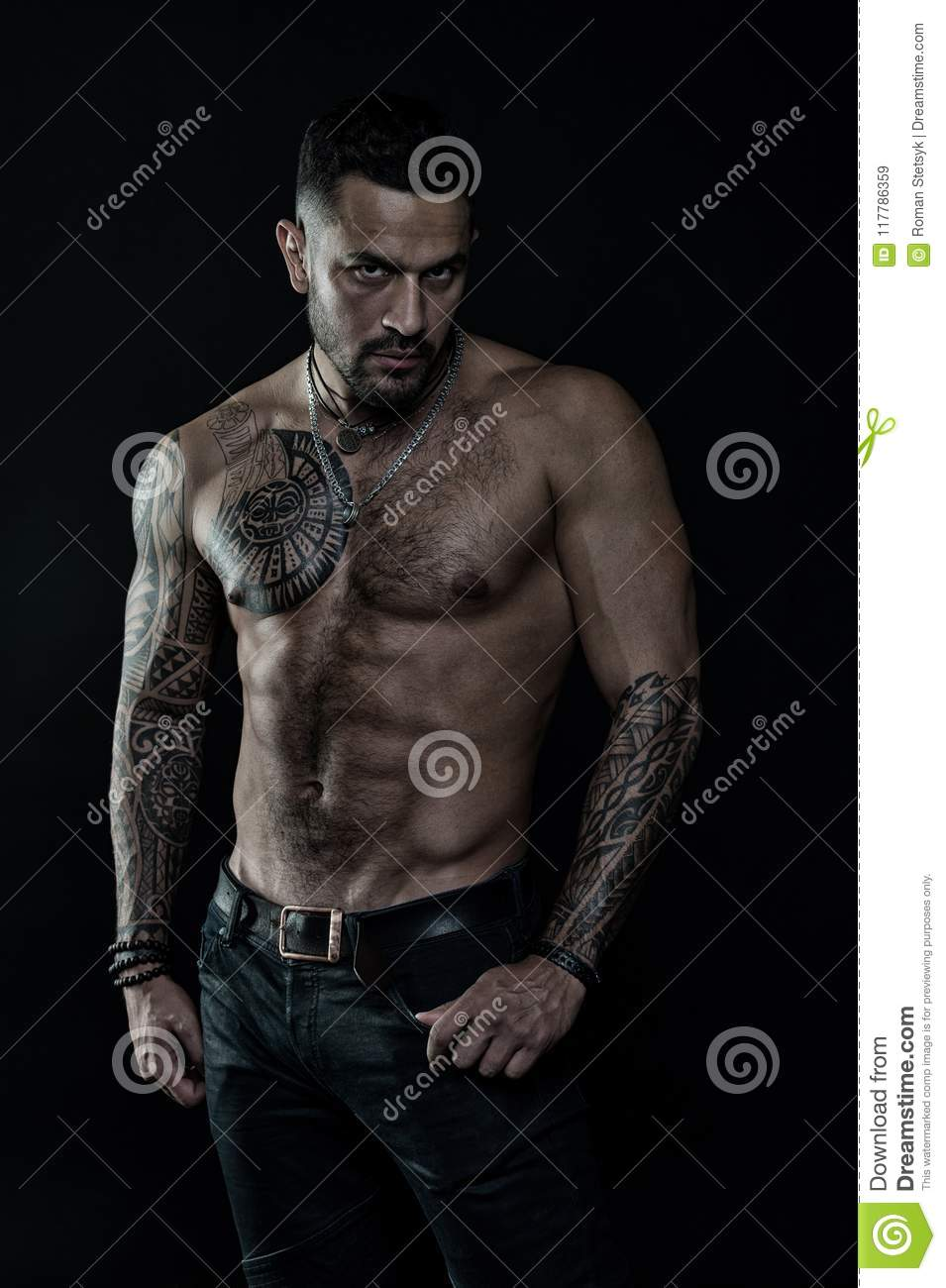 68c306b8902f72 Tattoo model with six pack and ab. Bearded man with tattooed body. Man with