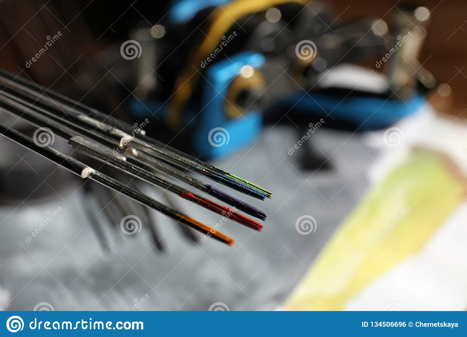 Tattoo Needles With Ink On Blurred Background Stock Photo - Image of ...