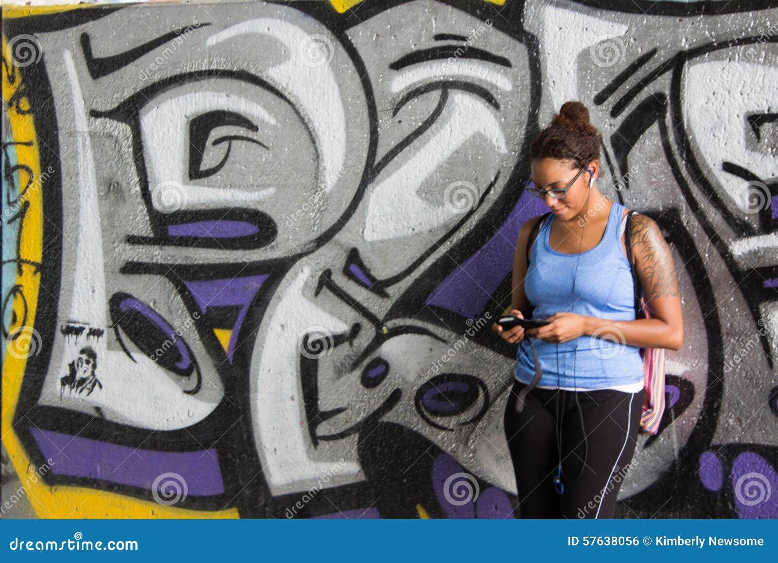 Graffiti wall tattoo - Tattooed Girl In Leaning On Graffiti Wall Royalty Free Stock Image