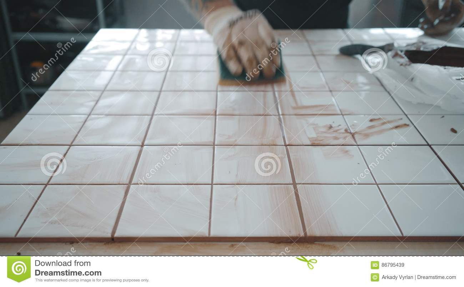 Tattooed Man Applies Ceramic Tiles On Kitchen Table Set Stock Video ...
