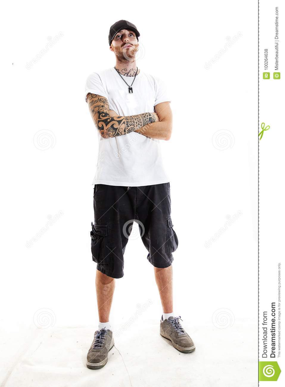 Rapper With Z Tattoed On His Face: Tattooed Rap Singer Posing In Studio Stock Photo
