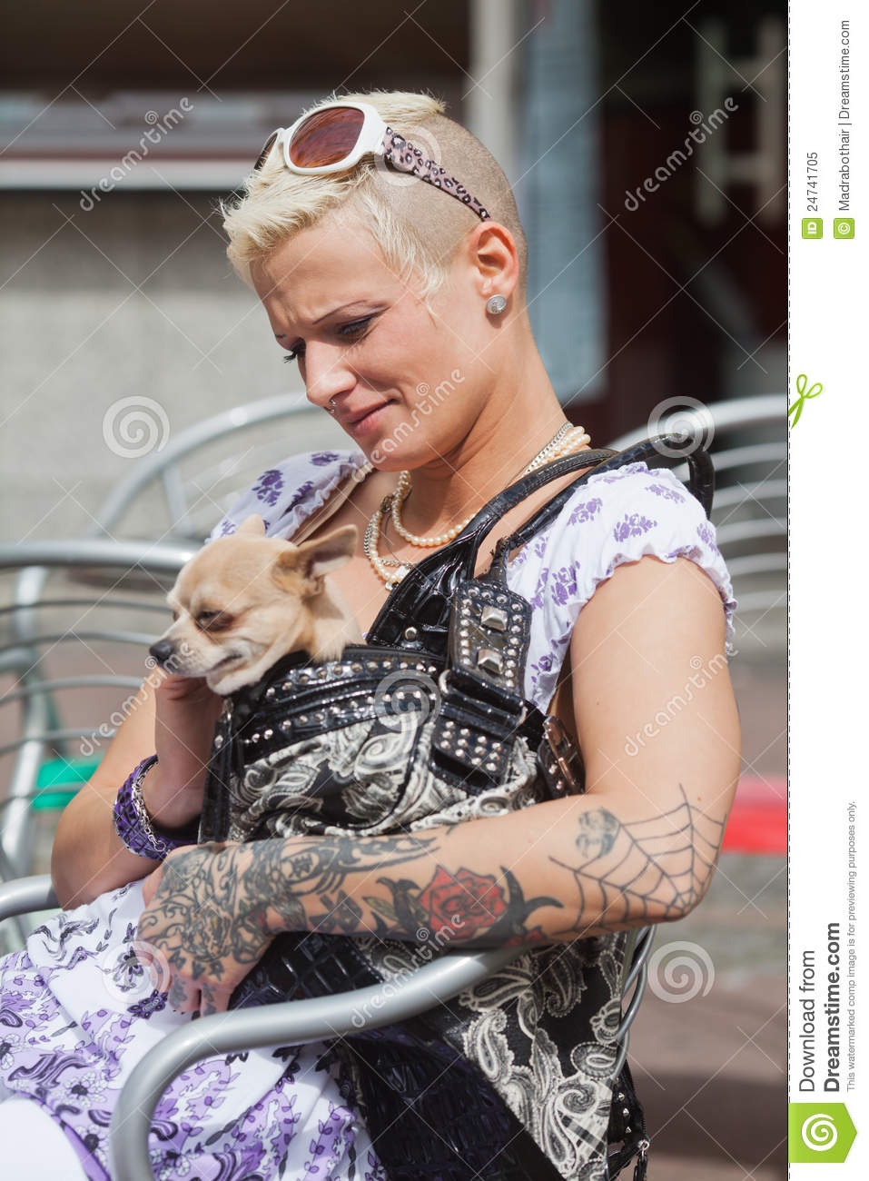 Tattooed Woman With A Dog In The Handbag Royalty Free