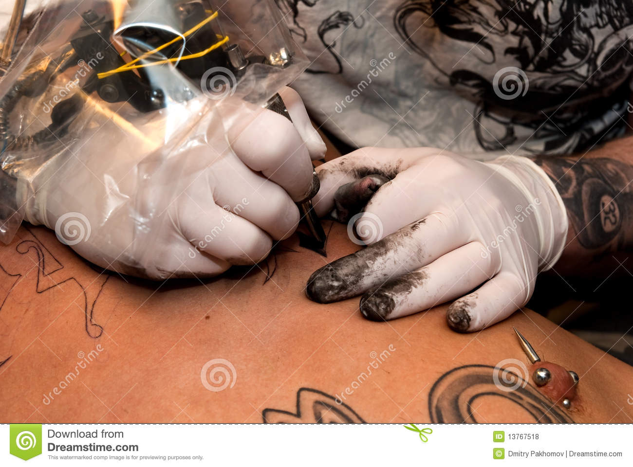 Tattooing process royalty free stock photos image 13767518 for Process of tattooing