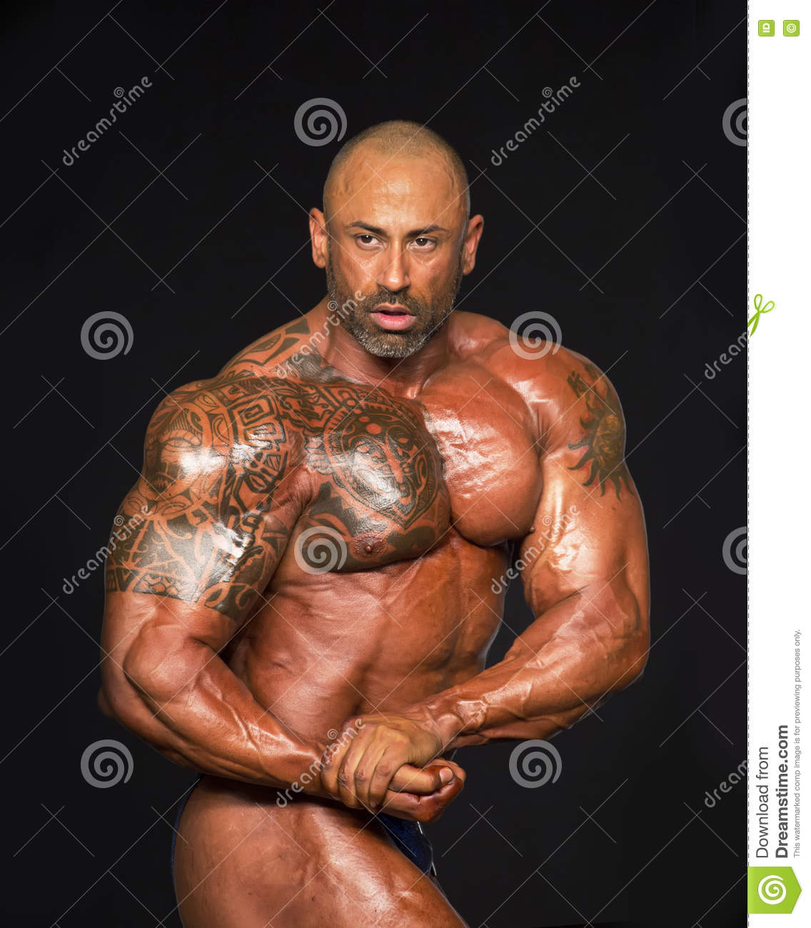 Tattoos and massive muscles editorial photo image 75829716 for Cotto new tattoo