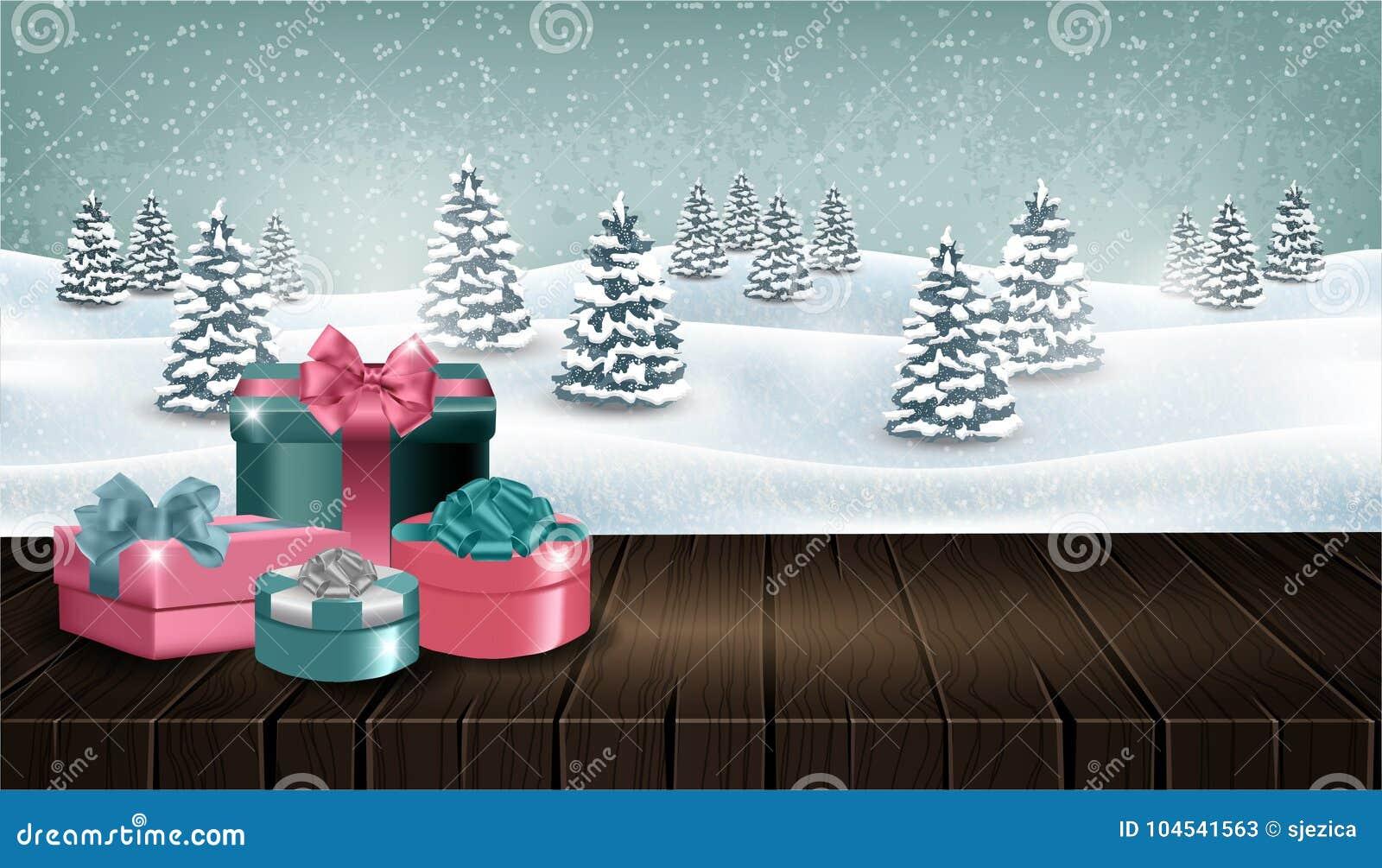 Tavola di legno con i giftboxes davanti al paesaggio della foresta di inverno